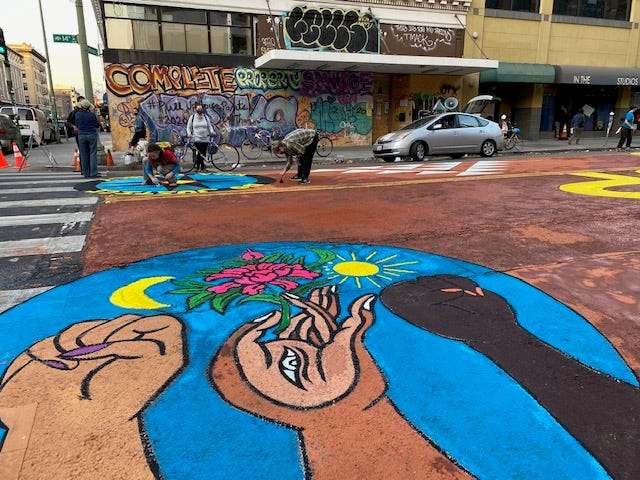The mural was created using clay from tribal lands in the Bay Area, so it will wash away in an environmentally-friendly way during the next rain.