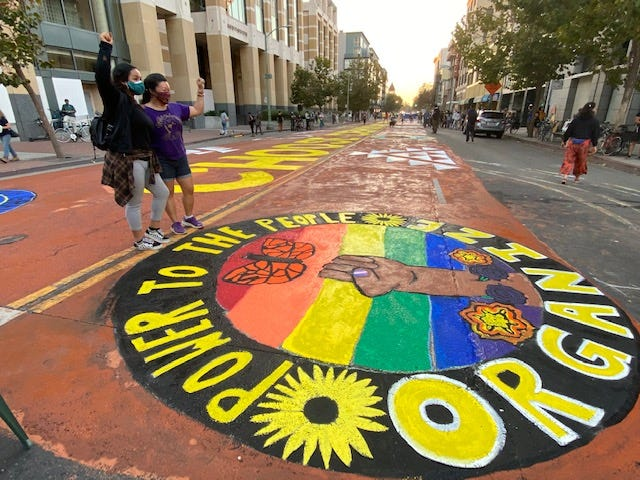 """The mural in downtown Oakland reads """"Power To The People"""" and """"Organize."""""""