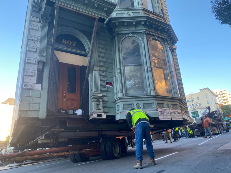 Giant dollies support the home, which went from 870 Franklin St. to its new location at 635 Fulton St. in San Francisco.