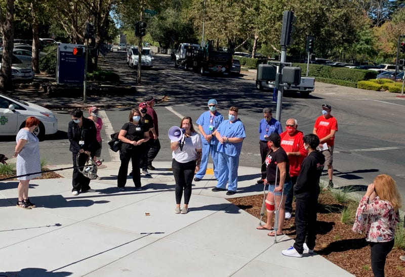 Workers at Memorial Hospital in Santa Rosa rally against the hospital's response to the pandemic.