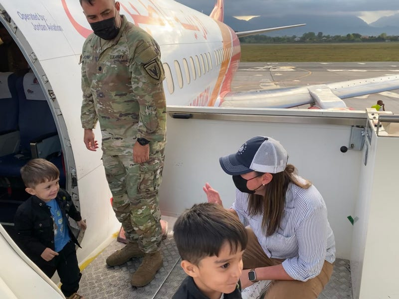 greeting two young boys off a second plane bringing evacuated Afghans SoA is supporting here in Albania (w/ the Office of Defense Cooperation Chief)