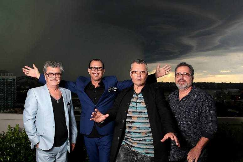 Tim Farriss, Kirk Pengilly, Jon Farriss and Andrew Farriss of INXS pose at the special Quadruple Platinum plaque presentation