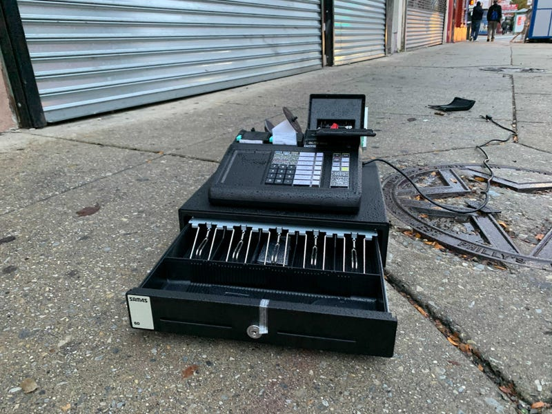 Looters pulled this cash register out of a store in West Philly during a period of unrest overnight.