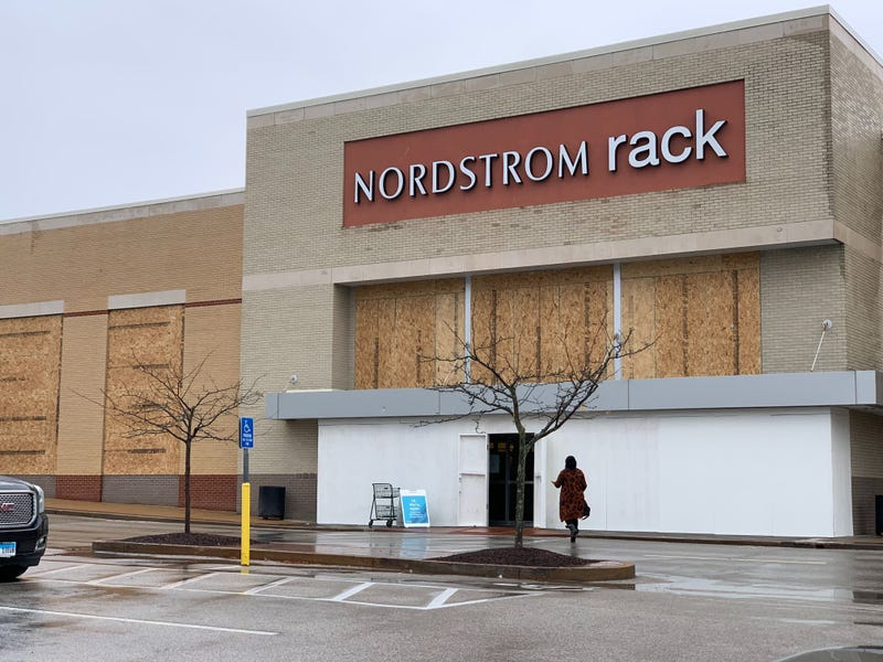 Nordstrom boards up their storefront before election night.