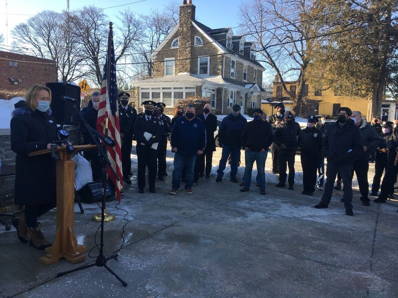 Philadelphia police officers and community members honor Officer Tab Ali, who died from COVID-19 in November.
