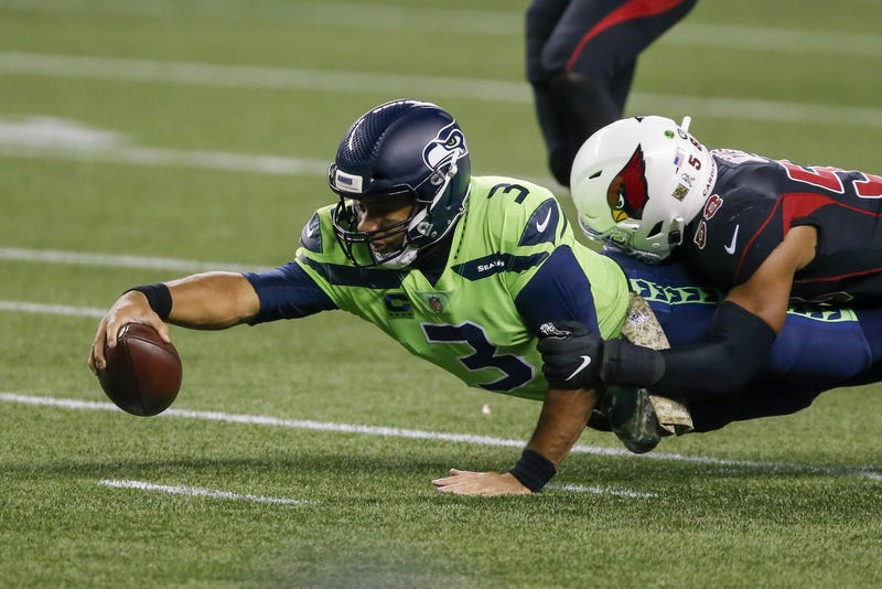 Russell Wilson stretches for extra yards while being tackled