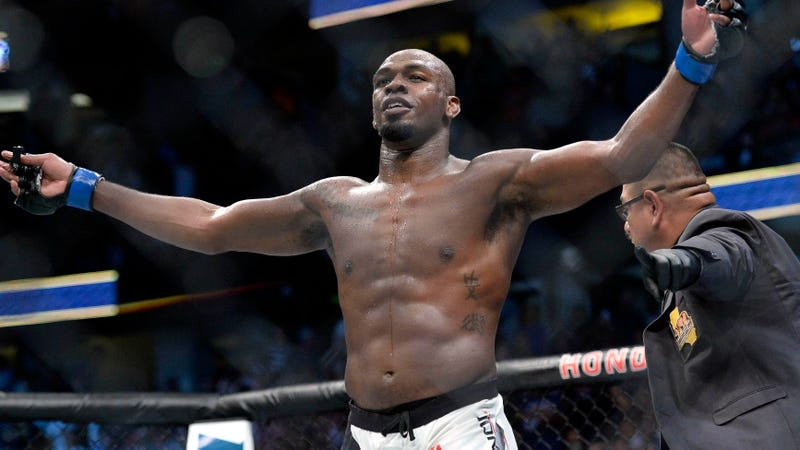 UFC star Jon Jones poses in the Octagon after fighting Daniel Cormier.
