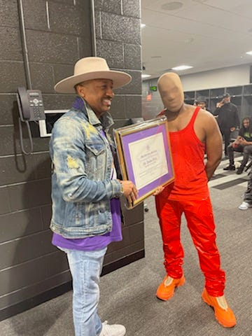 Morris Brown College gave Kanye West with a plaque honoring his late mother and a resolution recognizing Kanye.