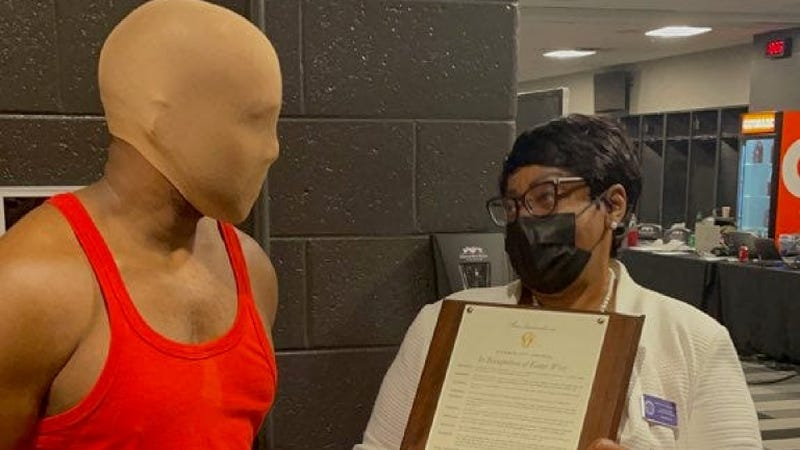 When Kanye West couldn't find his mask to take the Atlanta proclamation presentation photo, he quicly grabbed a stocking cap.