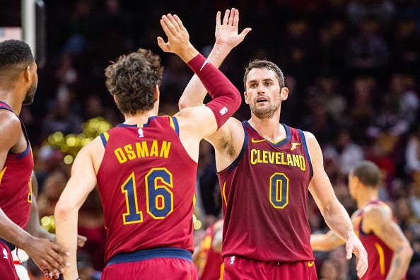 Kevin Love high fives teammate