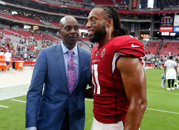 Jerry Rice, left, and Larry Fitzgerald