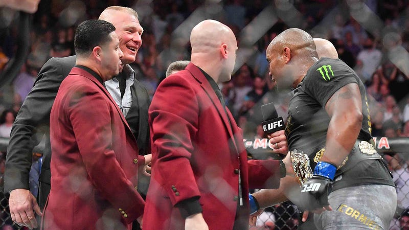 Brock Lesnar confronts UFC heavyweight champion Daniel Cormier in the cage at UFC 226.