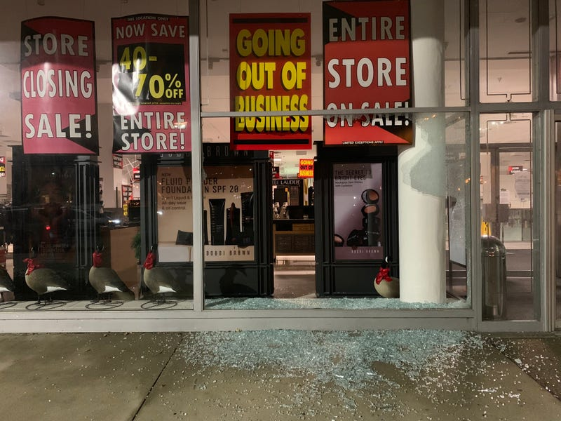 Broken glass remains after looters broke into the Lord & Taylor on City Avenue on Wednesday night.