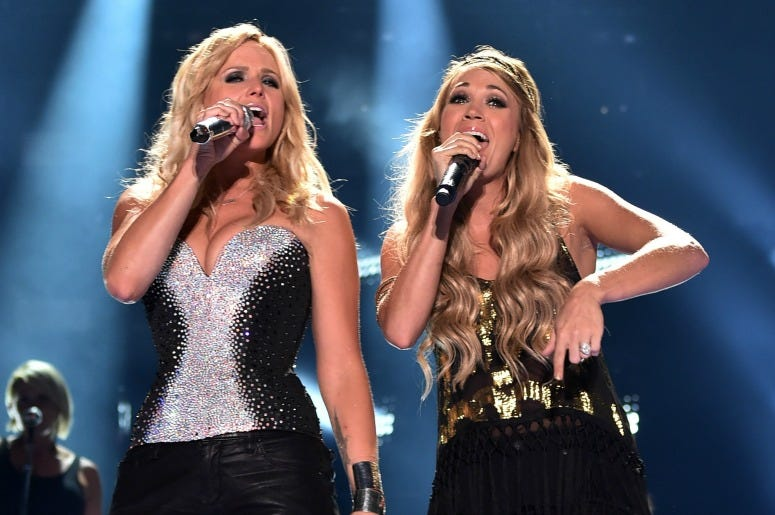 Miranda Lambert and Carrie Underwood perform during the 2014 CMA Festival