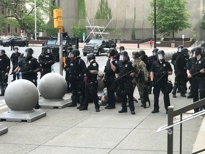 An elderly man is pushed by Buffalo Police when clearing Niagara Square. June 4, 2020
