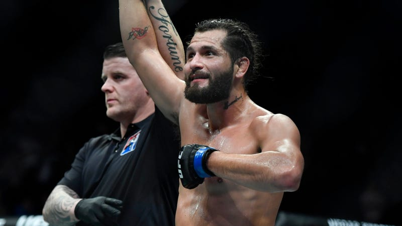 Jorge Masvidal gets his hand raised after knocking out Darren Till at UFC Fight Night 147 in London.