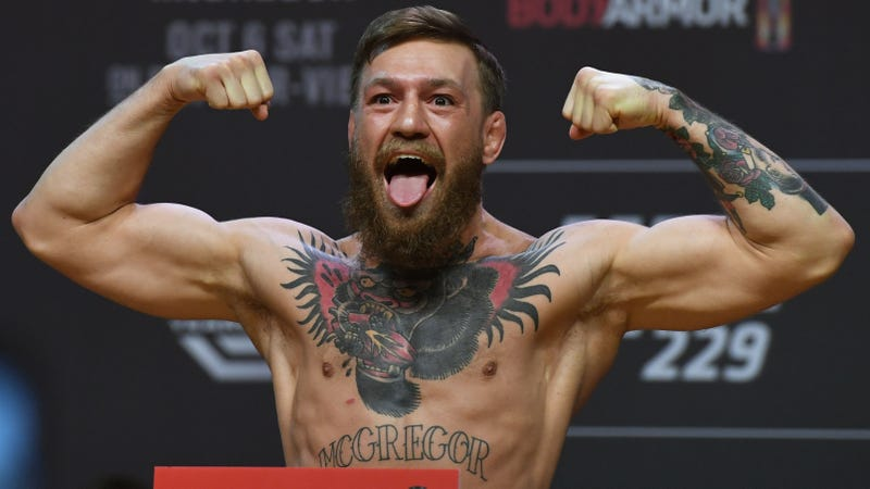 Conor McGregor poses at the weigh-in before UFC 229.