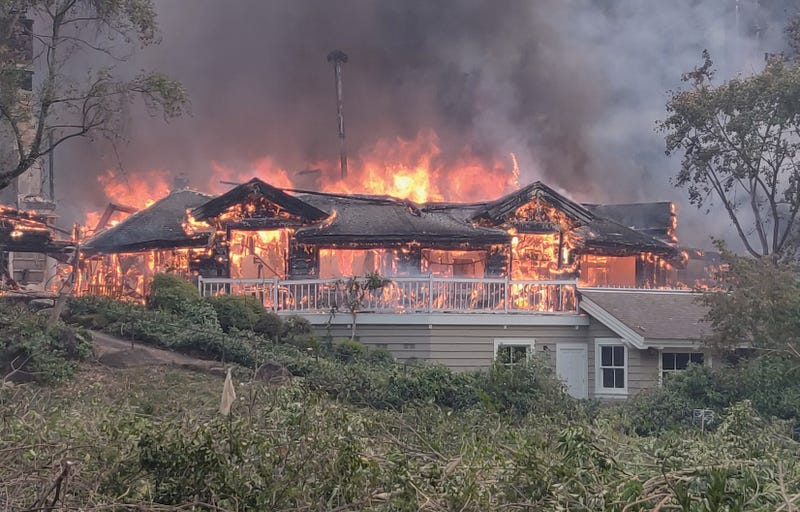 A portion of the five-star Meadowood resort burns.