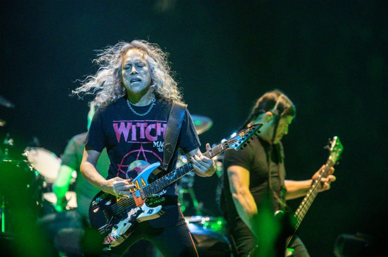 Metallica members Kirk Hammett, left, and Robert Trujillo perform as the band brings their WorldWired Tour to Bankers Life Fieldhouse