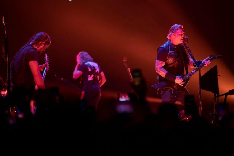 Metallica bassist Robert Trujillo, guitarist Kirk Hammett, and vocalist/guitarist James Hetfield