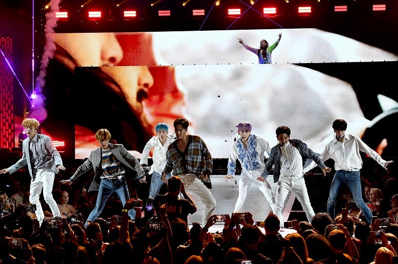 Monsta X perform onstage with Steve Aoki