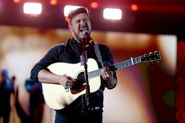 Marcus Mumford of Mumford & Sons performs onstage