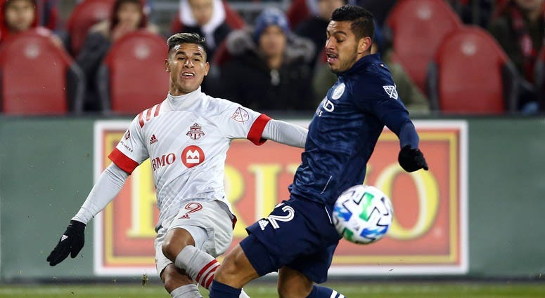 Erickson Gallardo of Toronto FC passes the ball as Ronald Matarrita of New York City FC defends during the second half of an MLS game at BMO Field on March 7, 2020 in Toronto, Canada.