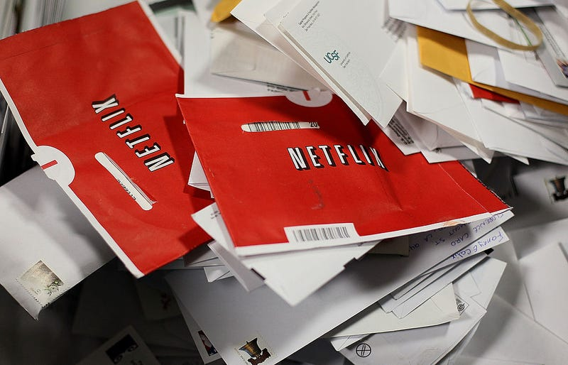 pile of mail with Netflix DVD delivery