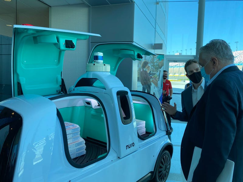 Nevada Gov. Steve Sisolak gets briefed on a new autonomous vehicle plant