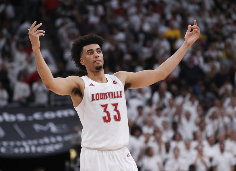 Louisville F Jordan Nwora (33) pumped up the crowd during the last seconds of their 58-43 win against No. 4 Michigan in Louisville, Ky. on Dec. 3, 2019. It was their first game after receiving the number 1 ranking. Uofl Mich06 Sam