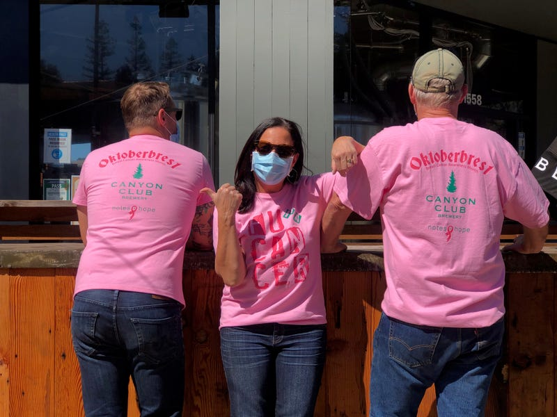 """The crew at Canyon Club Brewery in Moraga show off their """"Oktoberbrest"""" t-shirts."""