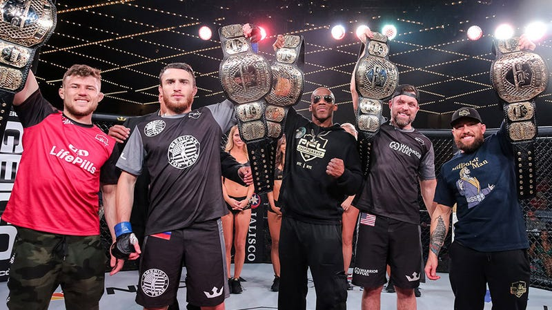 Professional Fighters League champions pose with their belts at PFL 11 at Madison Square Garden.