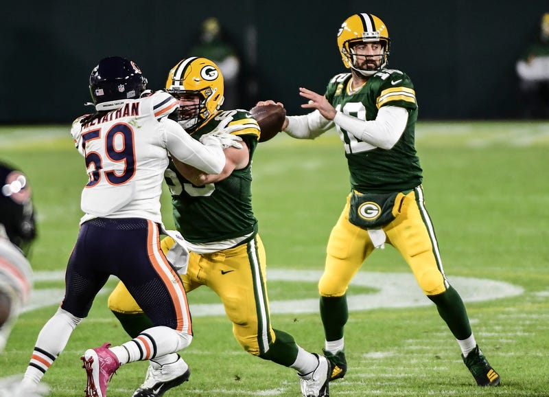 Nov 29, 2020; Green Bay, Wisconsin, USA; Green Bay Packers quarterback Aaron Rodgers (12) looks to pass in the first quarter during the game against the Chicago Bears at Lambeau Field. Mandatory Credit: Benny Sieu-USA TODAY Sports