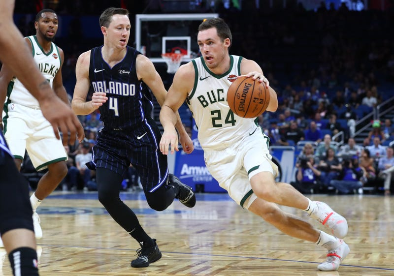 Nov 1, 2019; Orlando, FL, USA; Milwaukee Bucks guard Pat Connaughton (24) drives to the basket as Orlando Magic guard Josh Magette (4) defense during the second half at Amway Center. Mandatory Credit: Kim Klement-USA TODAY Sports