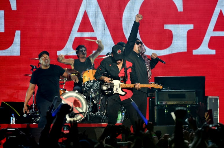 Tim Commerford, Chuck D, B-Real, Brad Wilk, B-Real and Tom Morello of Prophets of Rage perform