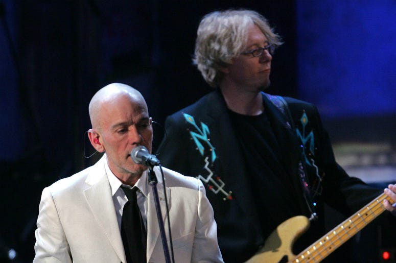 Michael Stipe and Mike Mills of R.E.M. perform at the 22nd annual Rock And Roll Hall Of Fame Induction Ceremony
