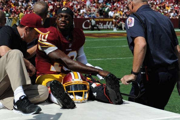 Robert Griffin III is carted off the field in 2014.