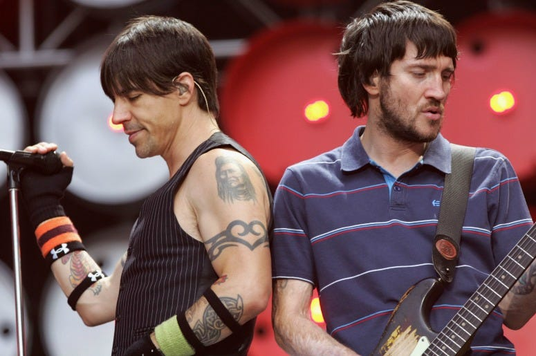 Anthony Kiedis and John Frusciante of the Red Hot Chilli Peppers performs on stage during the Live Earth concert at Wembley Stadium on July 7, 2007
