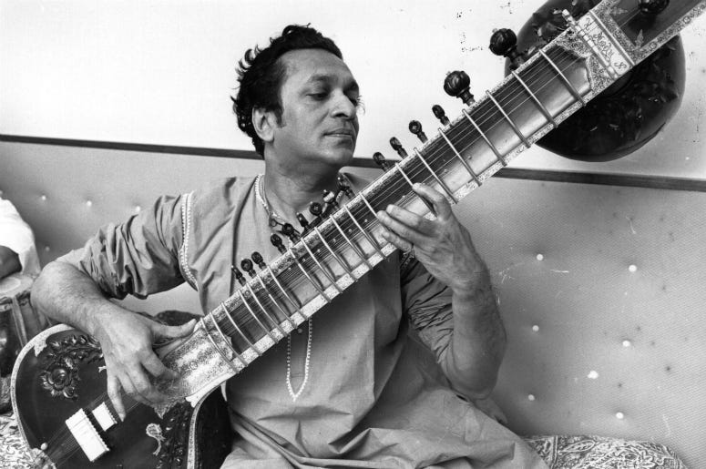 Ravi Shankar, the Indian composer and sitar player pictured playing