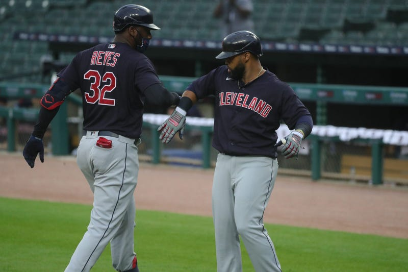 Cleveland Indians right fielder Franmil Reyes (32) is met by Carlos Santana (41) after his homer against Detroit Tigers starting pitcher Ivan Nova (43) during second inning action at Comerica Park, Friday, August 14, 2020.