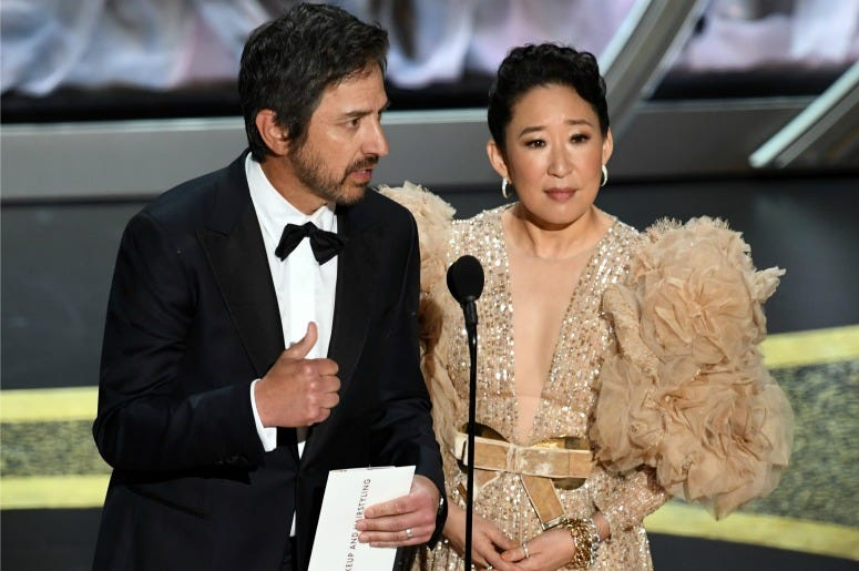 Ray Romano and Sandra Oh speak onstage during the 92nd Annual Academy Awards