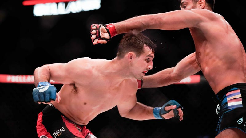 Rory MacDonald dodges a punch from Gegard Mousasi at Bellator 206.