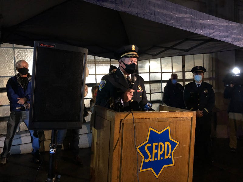 A former captain speaks at the memorial to honor fallen Officer James Guelff.