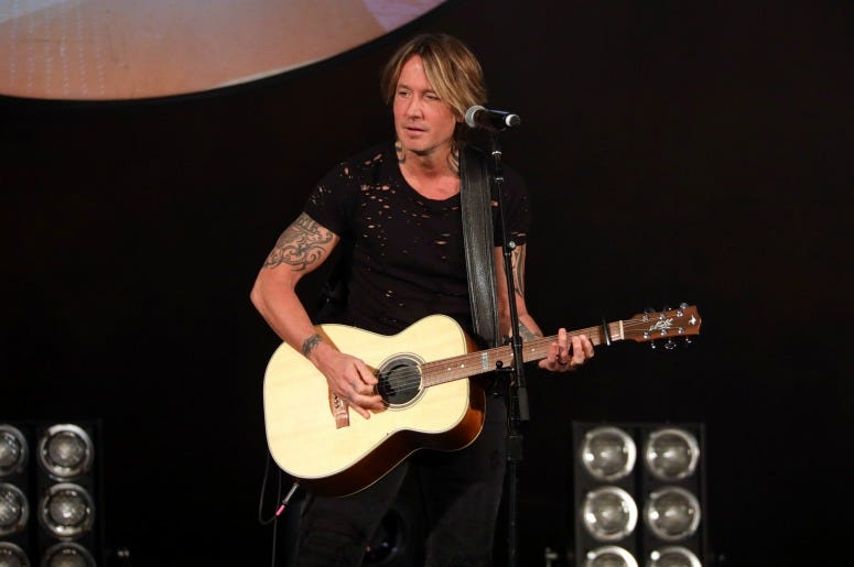 "Keith Urban performs on stage during ""Stars and Strings Presented by RAM Trucks Built to Serve,"" a RADIO.COM Event"