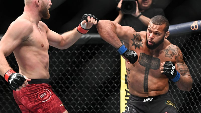 Thiago Santos blocks a punch from Jan Blachowicz in a win at UFC Fight Night 145 in Prague.