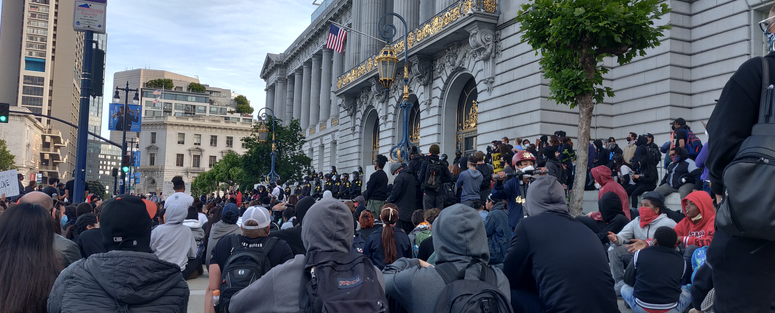 Protesters at a Sunday night event in front of San Francisco City Hall.
