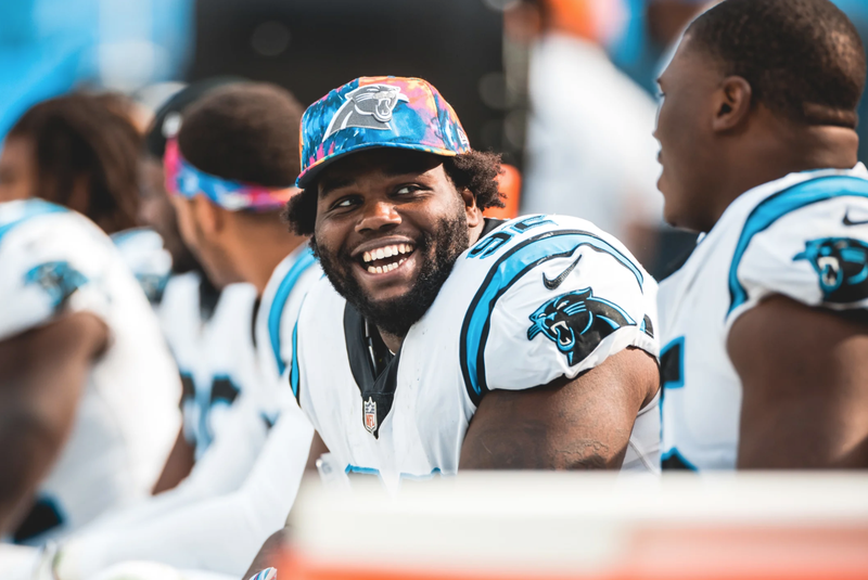 Zach Kerr on the Panthers bench with Derrick Brown