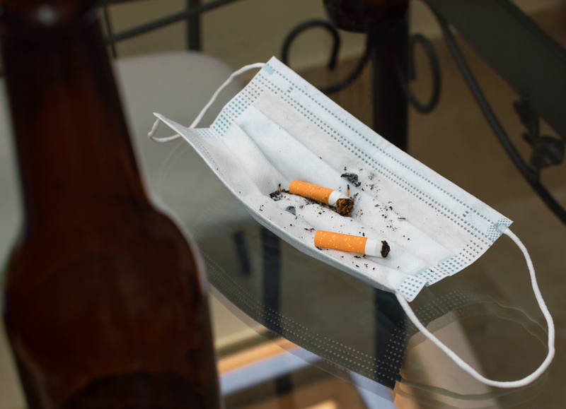 cigarette butts, beer bottle