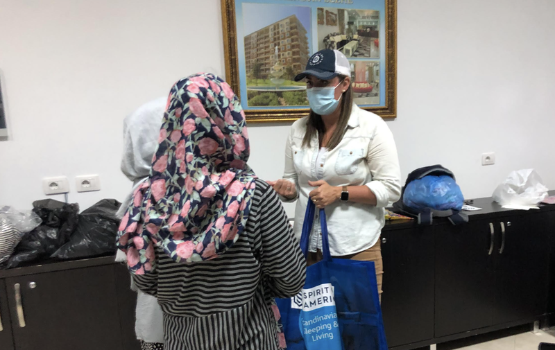 SoA handing out supplies to female scholars in our group