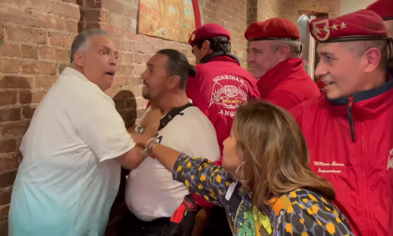 Patrons and members of the Guardian Angels, including Republican mayoral candidate Curtis Sliwa, attempt to break up a fight Friday night at Il Piccolo Buffalo in Little Italy.